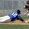 KEN YUSZKUS/Staff photo. Danvers' Ryan Kelleher dives back to 1st as Beverly's Kevin Cuneo gets the ball from the pitcher on a pick off try during the Beverly at Danvers baseball game at Twi-Field.      4/25/14