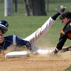 KEN YUSZKUS/Staff photo. Danvers' Ryan Kelleher is out 2nd with Beverly's Sean Curtin covering the base during the Beverly at Danvers baseball game at Twi-Field.      4/25/14