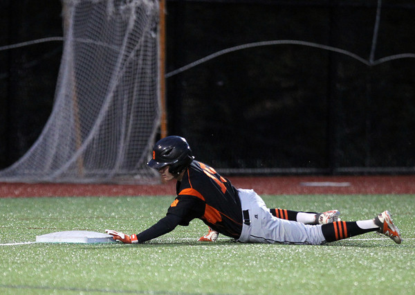 Beverly sophomore Nick Cotraro (15) slides safely headfirst into third base after advancing on a wild pickoff attempt from Belmont starter Brendan Shea. DAVID LE/Staff photo. 5/30/14.