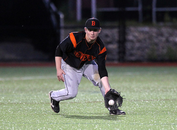 Beverly third baseman George Hillios makes a nice scoop on a short hopper and throws to first to retire a Belmont baserunner on Friday evening. DAVID LE/Staff photo. 5/30/14.