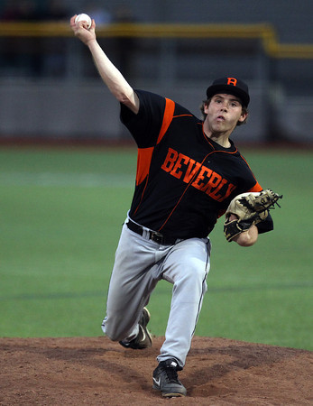 Beverly senior starting pitcher Eric Messina delivers a pitch against Belmont on Friday evening. DAVID LE/Staff photo. 5/30/14.