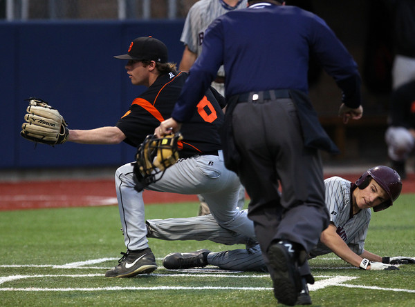 Belmont sophomore Trevor Kelly, right, slides safely into home as Beverly starting pitcher Eric Messina (8) waits for throw as Kelly scores the Marauders' second run of the game on a wild pitch. DAVID LE/Staff photo. 5/30/14.