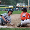 Danvers American first baseman JT Cashman (17) slides into third base as Beverly shortstop Brayden Clark swipes the tag across the bag on Tuesday evening at Harry Ball Field in Beverly. DAVID LE/Staff photo. 7/8/14.
