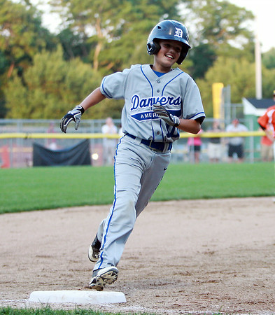 Danvers American second baseman Joe Thibodeau flashes a smile while rounding third base after he hit a solo home run off Beverly starter Shane Cassidy on Tuesday evening at Harry Ball Field in Beverly. DAVID LE/Staff photo. 7/8/14.