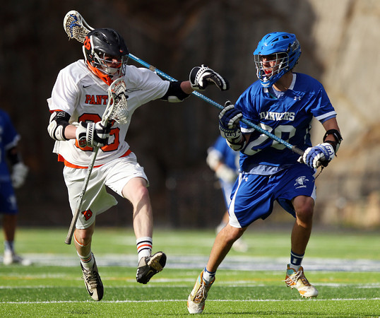 Beverly senior midfielder Nick Donovan (26) steps away from Danvers defense Anthony Serino (20) during the second half of play on Friday evening. The Panthers advanced past the Falcons 11-10 on a last second goal by senior attack Matt Page. DAVID LE/Staff photo. 5/30/14.