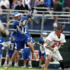 Danvers midfielder Zach Persson (17) takes a leaping shot while being closely contested by Beverly sophomore defense Sam Traicoff (6). The Panthers advanced past the Falcons 11-10 on a last second goal by senior attack Matt Page. DAVID LE/Staff photo. 5/30/14.