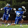 Danvers attack Trevor Chasse (25) celebrates his first quarter goal with attack Stephen Goutzos (5) on Friday evening at Endicott College in Beverly. DAVID LE/Staff photo. 5/30/14.