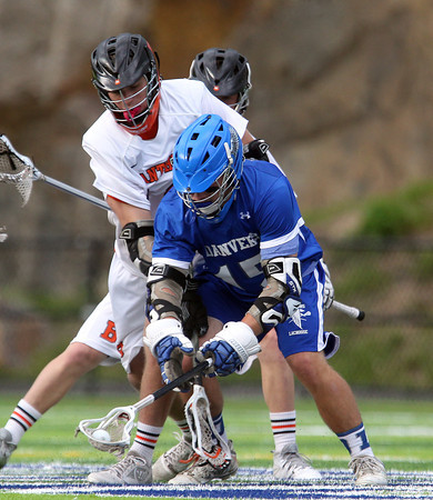 Danvers midfielder Stephen Ganley (15) scoops up a face-off after winning it away from Beverly senior midfielder Zach Duguid (16) during the first half of play. The Panthers advanced past the Falcons 11-10 on a last second goal by senior attack Matt Page. DAVID LE/Staff photo. 5/30/14.