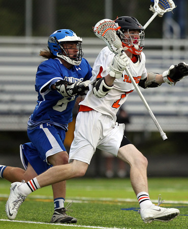 Beverly junior midfielder Ian Butler (1) darts past Danvers defense Jake Allain (8) and drives to the net on Friday evening. The Panthers advanced past the Falcons 11-10 on a last second goal by senior attack Matt Page. DAVID LE/Staff photo. 5/30/14.