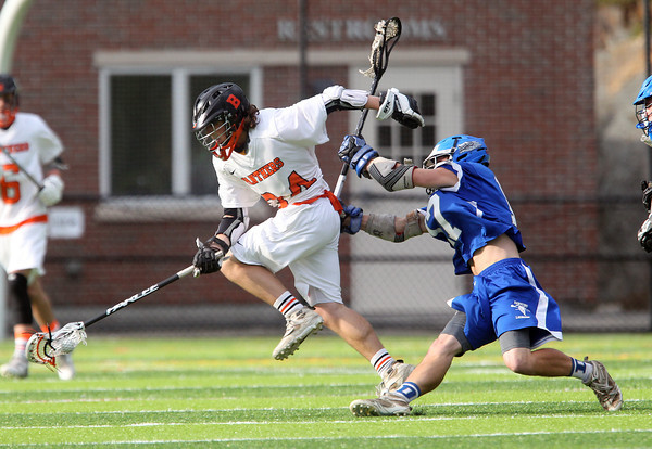 Beverly sophomore midfielder Jordan Rawding (34) evades a check from Danvers midfielder Zach Persson (17) and turns upfield on Friday evening at Endicott College in Beverly. The Panthers advanced past the Falcons 11-10 on a last second goal by senior attack Matt Page. DAVID LE/Staff photo. 5/30/14.