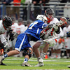 Beverly senior attack Matt Page (27) holds onto the ball while being checked by Danvers defense Drew Larsen (27) during the third quarter of play. The Panthers advanced past the Falcons 11-10 on a last second goal by senior attack Matt Page. DAVID LE/Staff photo. 5/30/14.