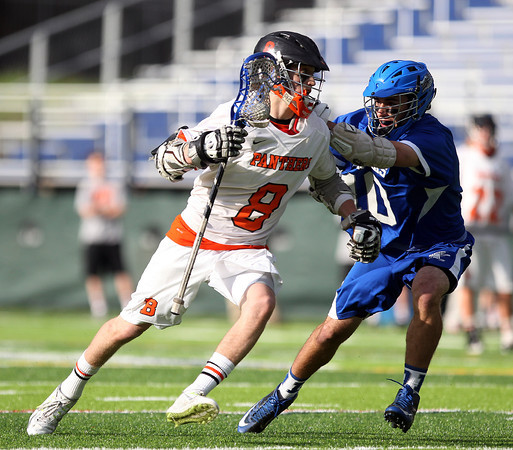 Beverly junior attack Nick Albano (8) tries to drive past Danvers midfielder Andrew Curtin (10) during the first half of play on Friday evening at Endicott College in Beverly. The Panthers advanced past the Falcons 11-10 on a last second goal by senior attack Matt Page. DAVID LE/Staff photo. 5/30/14.