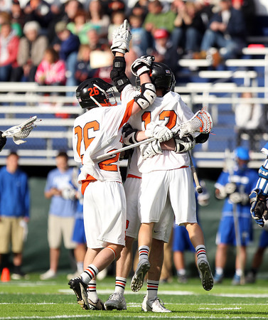 The Beverly Panthers celebrate a first half goal by sophomore attack Hunter Spencer (12). The Panthers advanced past the Falcons 11-10 on a last second goal by senior attack Matt Page. DAVID LE/Staff photo. 5/30/14.