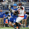 Danvers attack Troy Fleming (7) takes a shot on net while being stick checked by Beverly sophomore defense Sam Traicoff (6). The Panthers advanced past the Falcons 11-10 on a last second goal by senior attack Matt Page. DAVID LE/Staff photo. 5/30/14.