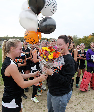 Danvers: Beverly senior captain Nicole Woods presents head coach Trish Murphy with flowers and balloons after Murphy recorded her 100th career win as coach of the Panthers.  David Le/Salem News
