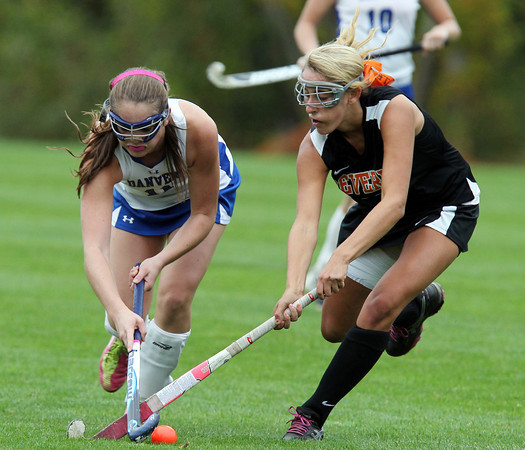 Danvers: Danvers junior Lauren Johnson (11) and Beverly senior Kate Silvestri (13) get tangled up as they battle for the ball on Tuesday afternoon. David Le/Salem News
