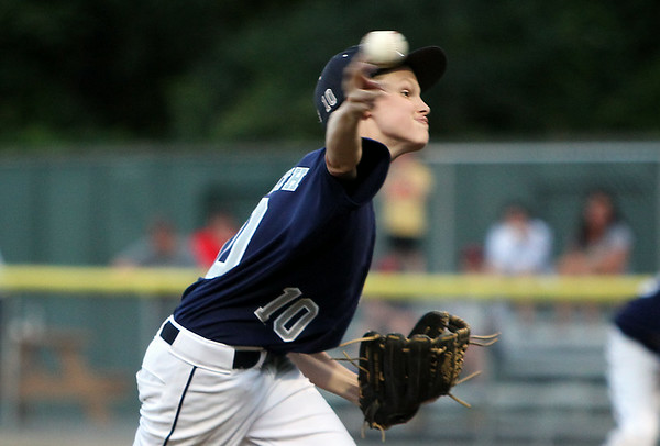 Hamilton-Wenham starting pitcher Cooper McGrath fires a pitch against Beverly on Thursday evening at Harry Ball Field in Beverly. DAVID LE/Staff photo. 7/10/14.
