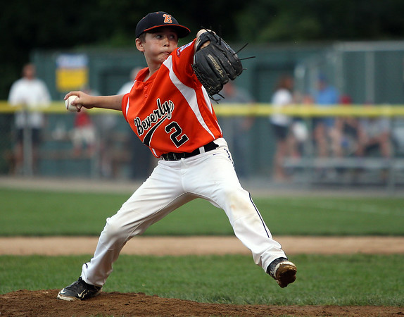 Beverly starting pitcher Brayden Clark fires a pitch against Hamilton-Wenham on Thursday evening at Harry Ball Field in Beverly. DAVID LE/Staff photo. 7/10/14.
