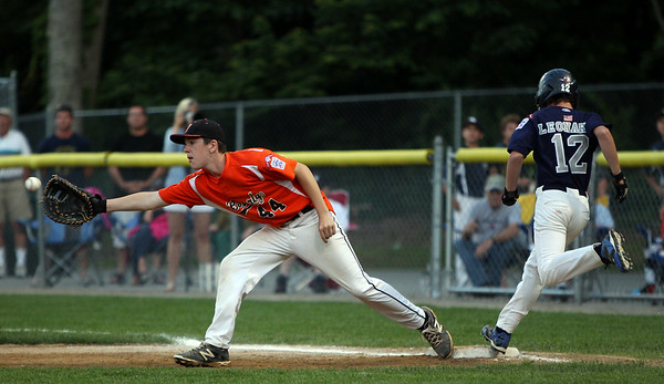 Beverly first baseman Robby Black (44) makes the stretch at first, but Hamilton-Wenham's Eli Leonard beats the throw for an infield single on Thursday evening at Harry Ball Field in Beverly. DAVID LE/Staff photo. 7/10/14.