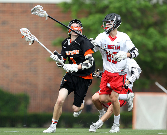 Beverly junior midfielder Ian Butler (1) finds himself with a face full of Hingham senior Jackson Ullrich's stick in the D2 State Semifinal at Harvard Stadium on Tuesday afternoon. DAVID LE/Staff photo. 6/10/14.