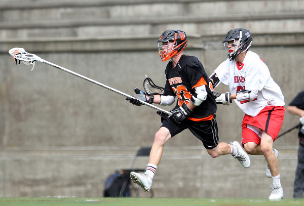 Beverly junior defense Bryan Flaherty races towards the net while being closely chased by a Hingham player in the D2 State Semifinal at Harvard Stadium on Tuesday afternoon. DAVID LE/Staff photo. 6/10/14.