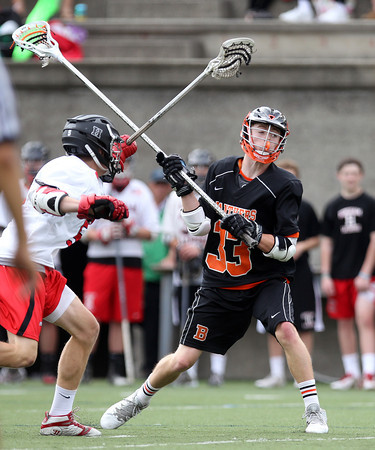 Beverly junior defense Bryan Flaherty (33) fires a shot on net in the D2 State Semifinal at Harvard Stadium on Tuesday afternoon. DAVID LE/Staff photo. 6/10/14.