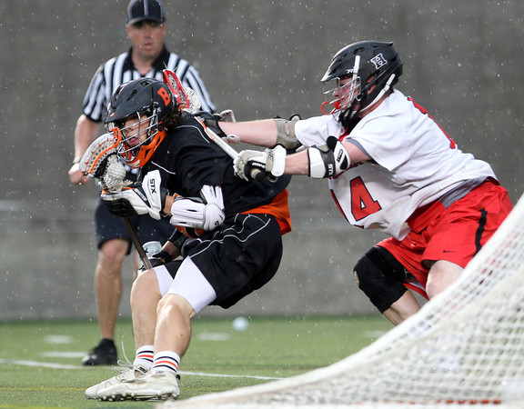 Beverly sophomore midfielder Jordan Rawding tries to get to the net while being checked by Hingham senior Patrick Burke (14) in the D2 State Semifinal at Harvard Stadium on Tuesday afternoon. DAVID LE/Staff photo. 6/10/14.