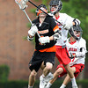 Beverly junior midfielder Ian Butler (1) gets the stick of Hingham senior defense Jackson Ullrich up in his face as he tries to drive to the net during the second quarter of play in the D2 State Semifinal at Harvard Stadium on Tuesday afternoon. DAVID LE/Staff photo. 6/10/14.