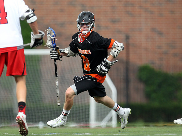 Beverly junior attack Nick Albano looks for room to run in the D2 State Semifinal at Harvard Stadium on Tuesday afternoon. DAVID LE/Staff photo. 6/10/14.