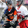 Beverly junior attack Nick Albano (8) goes nose-to-nose with Hingham senior defense John Melia (17) in the D2 State Semifinal at Harvard Stadium on Tuesday afternoon. DAVID LE/Staff photo. 6/10/14.