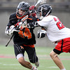 Beverly sophomore midfielder Jordan Rawding (34) tries to get past Hingham junior Will Vazquez while being stick checked in the D2 State Semifinal at Harvard Stadium on Tuesday afternoon. DAVID LE/Staff photo. 6/10/14.