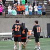 Beverly senior captains Matt Page (27) and Kevin Lally (2), along with junior Clinton Cabral, slowly walk off the field to the applause of the Beverly faithful after a heartbreaking 9-8 loss in the D2 State Semifinal at Harvard Stadium on Tuesday afternoon. DAVID LE/Staff photo. 6/10/14.
