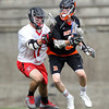 Beverly junior Nick Albano squares off against Hingham senior John Melia (17) in the D2 State Semifinal at Harvard Stadium on Tuesday afternoon. DAVID LE/Staff photo. 6/10/14.