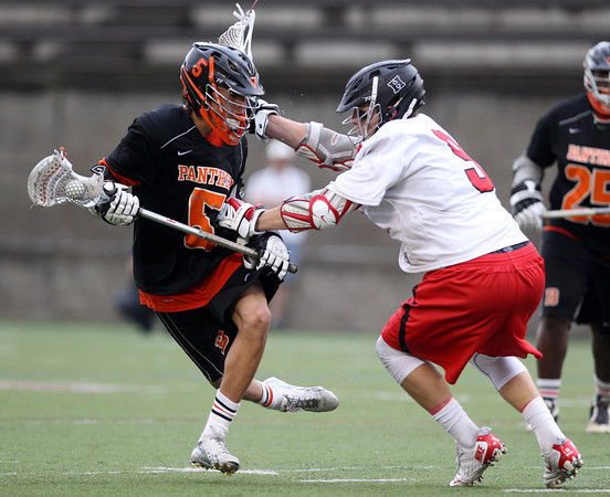 Beverly freshman midfielder Sam Abate dodges away from the check of Hingham senior midfielder Caleb Brodie (9) during the overtime period in the D2 State Semifinal at Harvard Stadium on Tuesday afternoon. DAVID LE/Staff photo. 6/10/14.