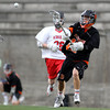 Beverly sophomore attack Hunter Spencer fires a shot on net against Hingham in the D2 State Semifinal at Harvard Stadium on Tuesday afternoon. DAVID LE/Staff photo. 6/10/14.