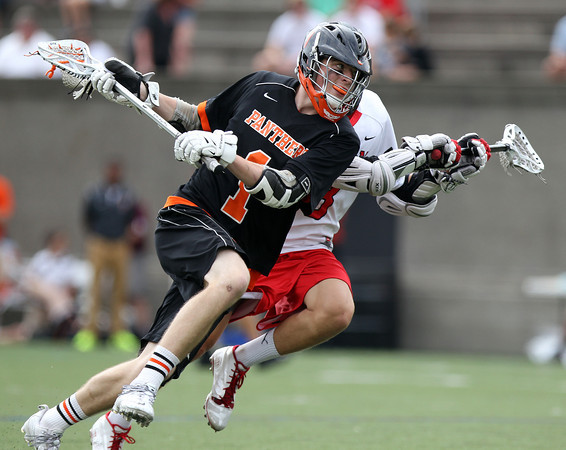 Beverly junior midfielder Ian Butler (1) lines up a shot on net against Hingham in the D2 State Semifinal at Harvard Stadium on Tuesday afternoon. DAVID LE/Staff photo. 6/10/14.