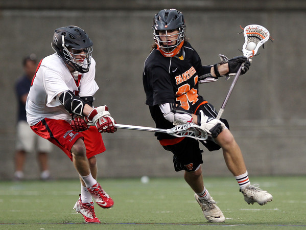 Beverly sophomore midfielder Jordan Rawding (34) blows past a Hingham defender in the D2 State Semifinal at Harvard Stadium on Tuesday afternoon. DAVID LE/Staff photo. 6/10/14.