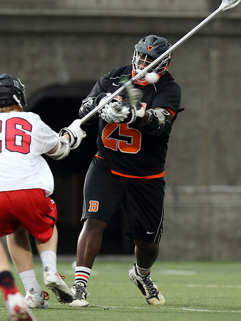 Beverly senior Rick McFarland (25) rifles home a third quarter goal against Hingham in the D2 State Semifinal at Harvard Stadium on Tuesday afternoon. DAVID LE/Staff photo. 6/10/14.