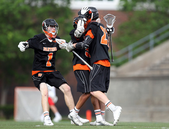 Beverly senior captain Matt Page (27) celebrates his second quarter goal with freshman Sam Abate (5) and junior Ian Butler (1) in the D2 State Semifinal at Harvard Stadium on Tuesday afternoon. DAVID LE/Staff photo. 6/10/14.