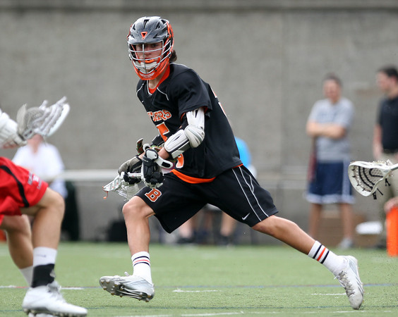 Freshman midfielder Sam Abate looks to make a play  in the D2 State Semifinal at Harvard Stadium on Tuesday afternoon. DAVID LE/Staff photo. 6/10/14.