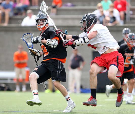 Beverly junior attack Nick Albano (8) tries to get past Hingham senior John Melia (17) in the D2 State Semifinal at Harvard Stadium on Tuesday afternoon. DAVID LE/Staff photo. 6/10/14.