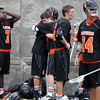 Beverly players stand in stunned silence after they fell in an overtime contest, 9-8 to Hingham in the D2 State Semifinal at Harvard Stadium on Tuesday afternoon. DAVID LE/Staff photo. 6/10/14.