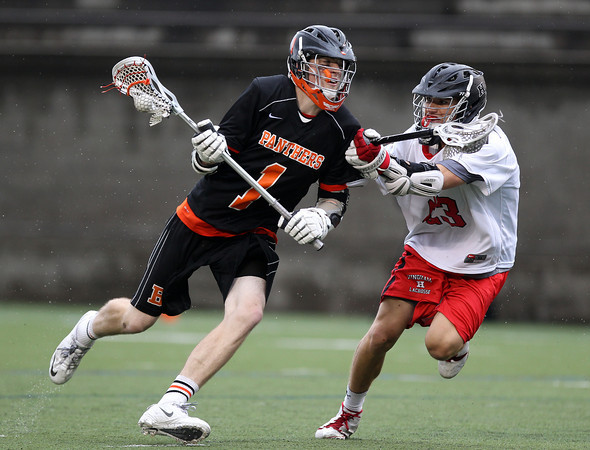 Beverly junior midfielder Ian Butler (1) drives to the net against Hingham sophomore midfielder Kevin Shoyer (23) in the D2 State Semifinal at Harvard Stadium on Tuesday afternoon. DAVID LE/Staff photo. 6/10/14.