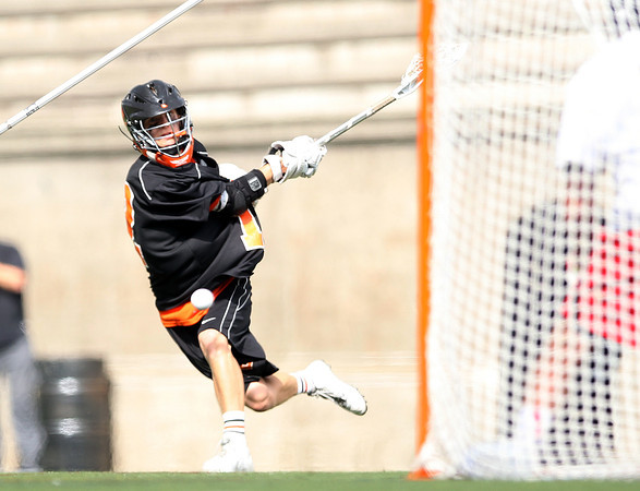 Beverly sophomore attack Hunter Spencer rifles home a goal during the second quarter of play in the D2 State Semifinal at Harvard Stadium on Tuesday afternoon. DAVID LE/Staff photo. 6/10/14.