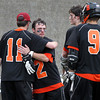 Beverly senior captain Kevin Lally (2) gets a hug from senior teammate Ryan Hagerty (11) after the Panthers fell to Hingham in overtime in the D2 State Semifinal at Harvard Stadium on Tuesday afternoon. DAVID LE/Staff photo. 6/10/14.
