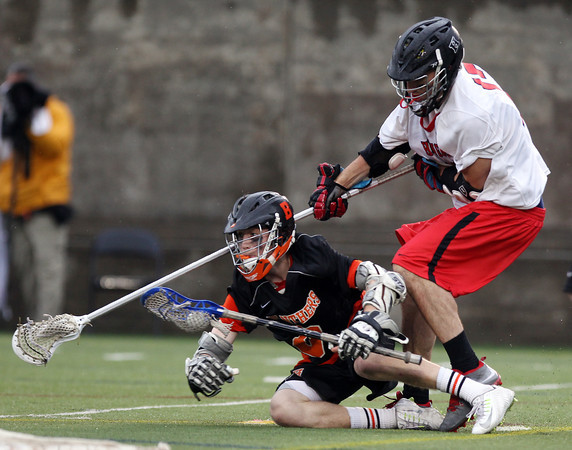 Beverly junior Nick Albano looks to make a play after being taken down in the D2 State Semifinal at Harvard Stadium on Tuesday afternoon. DAVID LE/Staff photo. 6/10/14.