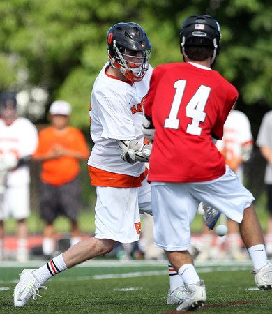 Beverly junior Nick Albano rifles home one of his four goals against Marblehead. Behind four goals and five assists from junior attack Nick Albano the Panthers downed the Magicians 12-6 to capture the D2 North Title at Bertram Field in Salem on Saturday afternoon. DAVID LE/Staff photo. 6/7/14.