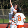Beverly senior captain Kevin Lally points skyward and lets out a shout of celebration while being picked high up in the air by senior captain Ty Martz (3). Behind four goals and five assists from junior attack Nick Albano the Panthers downed the Magicians 12-6 to capture the D2 North Title at Bertram Field in Salem on Saturday afternoon. DAVID LE/Staff photo. 6/7/14.