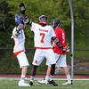 Beverly sophomore Peter Mulumba (7) celebrates his first quarter goal against Marblehead with junior Nick Albano (8). Behind four goals and five assists from junior attack Nick Albano the Panthers downed the Magicians 12-6 to capture the D2 North Title at Bertram Field in Salem on Saturday afternoon. DAVID LE/Staff photo. 6/7/14.