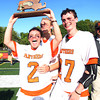 Beverly senior captain Kevin Lally (2) hoists the D2 North Championship trophy high in the air and screams in celebration with fellow senior captains Ty Martz and Matt Page (27). Behind four goals and five assists from junior attack Nick Albano the Panthers downed the Magicians 12-6 to capture the D2 North Title at Bertram Field in Salem on Saturday afternoon. DAVID LE/Staff photo. 6/7/14.